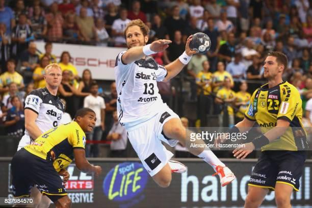 Steffen Weinhold of Kiel scores a goal during the Pixum DHB Handball Super Cup 2017 between RheinNeckar Loewen and THW Kiel at PorscheArena on August...
