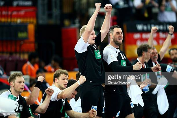 Steffen Weinhold Paul Drux Patrick Wiencek and Jens Schoengarth of Germany celebrate a goal during the IHF Men's Handball World Championship group D...