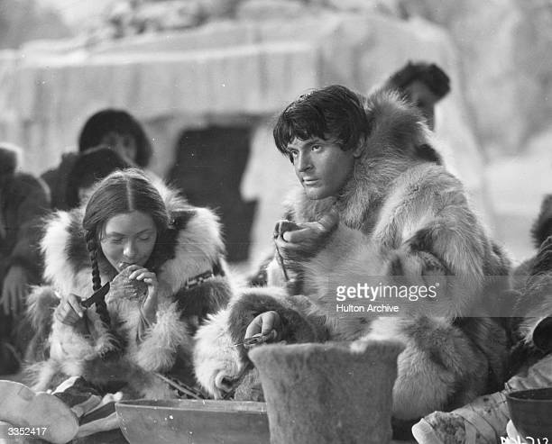 Steffi Duna and Francis Lederer enjoying an Inuit feast scene in the RKO Radio Pictures film 'Man Of Two Worlds' The film was directed by J Walter...