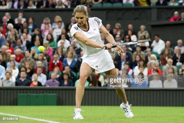Steffi Graf hits a backhand during the Ladies Singles match against Kim Clijsters during the 'Centre Court Celebration' at Wimbledon on May 17 2009...