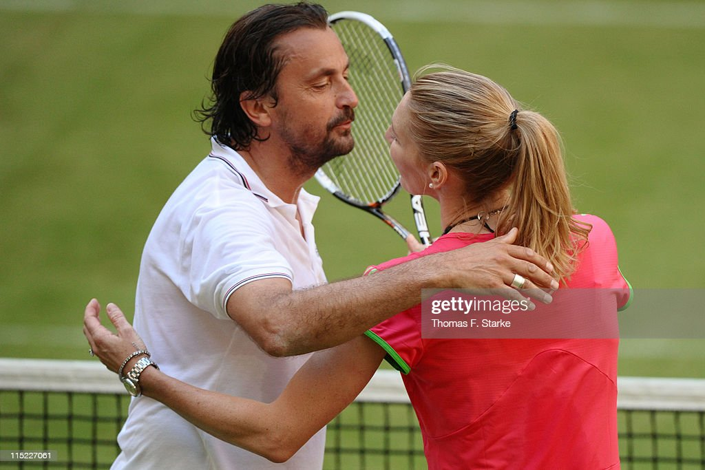 Steffi Graf (R) hugs Henri Leconte after winning the Warsteiner Champions Trophy of the Gerry Weber Open at the Gerry Weber stadium on June 4, 2011 in Halle, Germany.