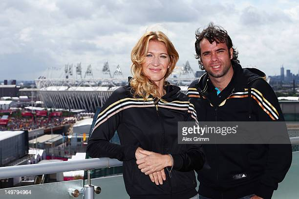 Steffi Graf of Germany and Fernando Gonzalez of Chile at the adidas Olympic Media Lounge at Westfield Stratford City on August 4 2012 in London...