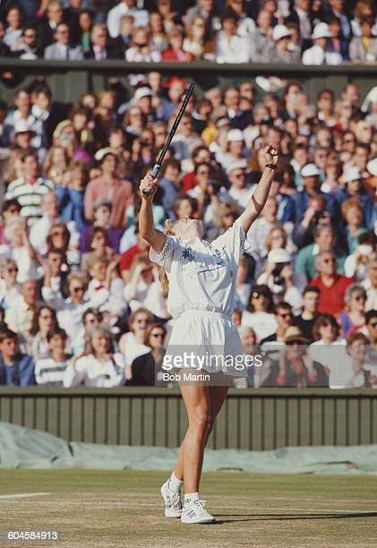 Steffi Graf of Germany celebrates winning the Women's Singles Final against Martina Navratilova at the Wimbledon Lawn Tennis Championship on 3 July...