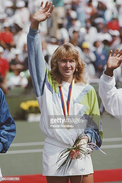 Steffi Graf of Germany celebrates with the gold medal after winning her Women's Singles Final match against Gabriela Sabatini on 30 September 1988...