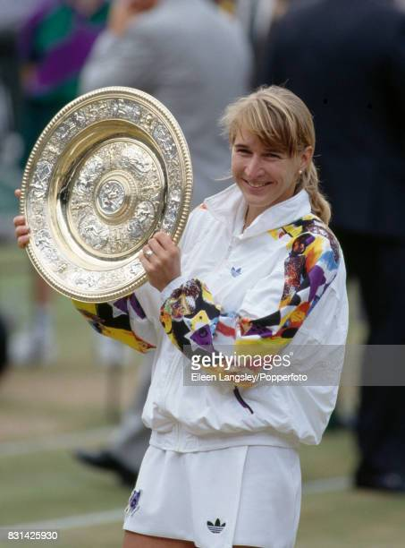 Steffi Graf of Germany holds the trophy aloft after she won the women's singles final by defeating Jana Novotna of Czecholslovakia in three sets...