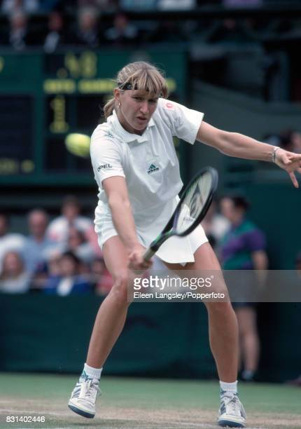 Steffi Graf of Germany in action during a women's singles match at the Wimbledon Lawn Tennis Championships in London circa July 1991 Graf won the...