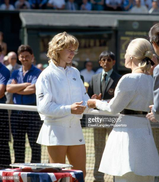 Steffi Graf of Germany receives the runnersup trophy from the Duchess of Kent after Graf's women's singles final defeat by Martina Navratilova of the...