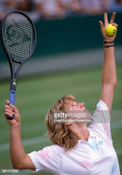 Steffi Graf of Germany serves during a women's singles match at the Wimbledon Lawn Tennis Championships in London circa July 1987 Graf was defeated...