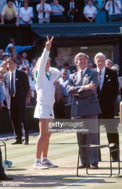 Steffi Graf of Germany signals V for Victory after her women's singles final win over Gabriela Sabatini of Argentina in three sets during the...