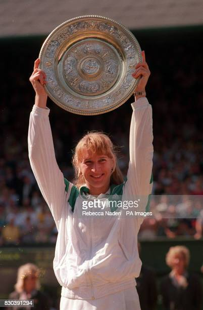 Steffi Graf raises the women's singles trophy at Wimbeldon after beating Gabriela Sabatini in the final