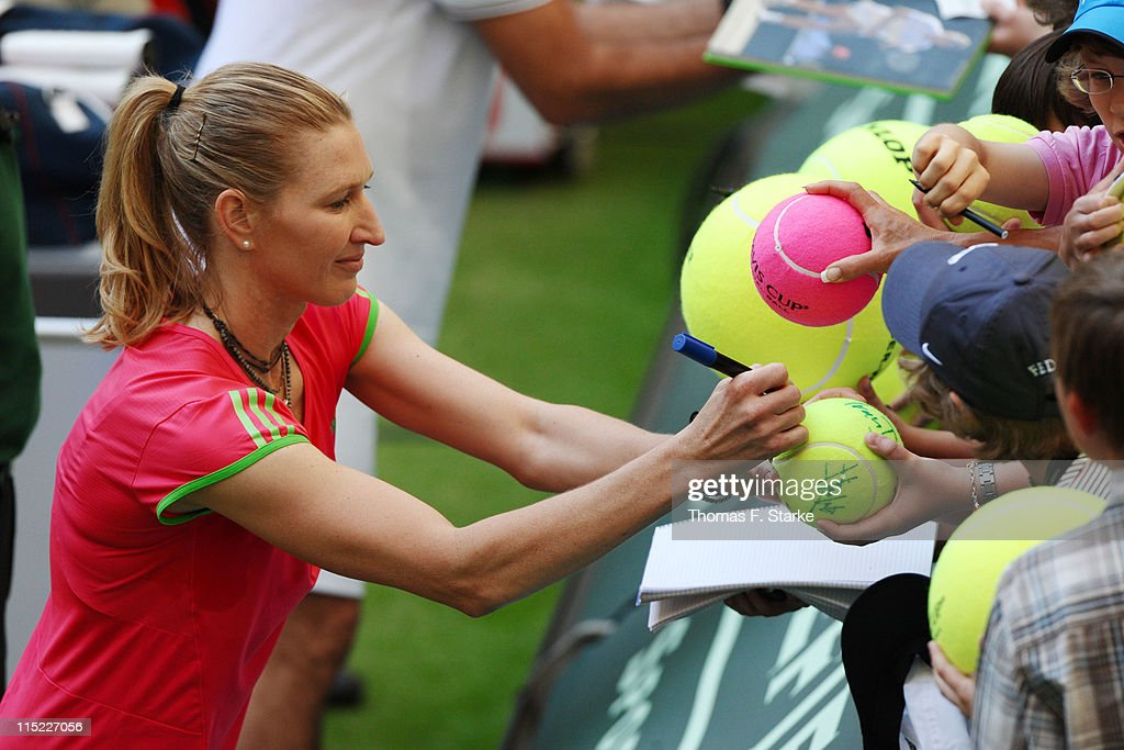 Steffi Graf (L) signs autographs after the Warsteiner Champions Trophy of the Gerry Weber Open at the Gerry Weber stadium on June 4, 2011 in Halle, Germany.