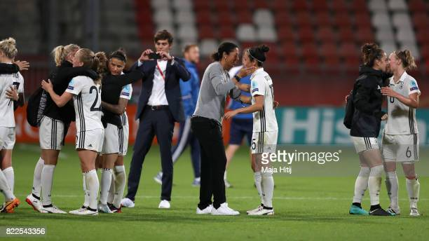 Steffi Jones head coach of Germany and Sara DoorsounKhajeh of Germany embrace after the Group B match between Russia and Germany during the UEFA...