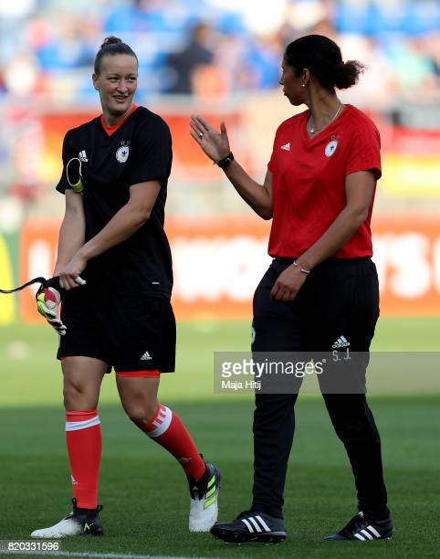 Steffi Jones head coach of Germany talks to goalkeeper Almuth Schult during the Group B match between Germany and Italy during the UEFA Women's Euro...