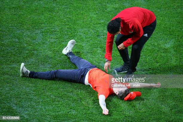 Steffi Jones manager / head coach of Germany Women checks on a volunteer who slipped over on the wet pitch before the UEFA Women's Euro 2017 match...