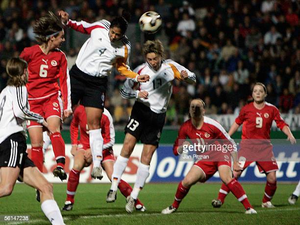 Steffi Jones of Germany scores the first goal during the Women's FIFA World Cup 2007 qualifier between Germany and Switzerland at the Donau Stadium...