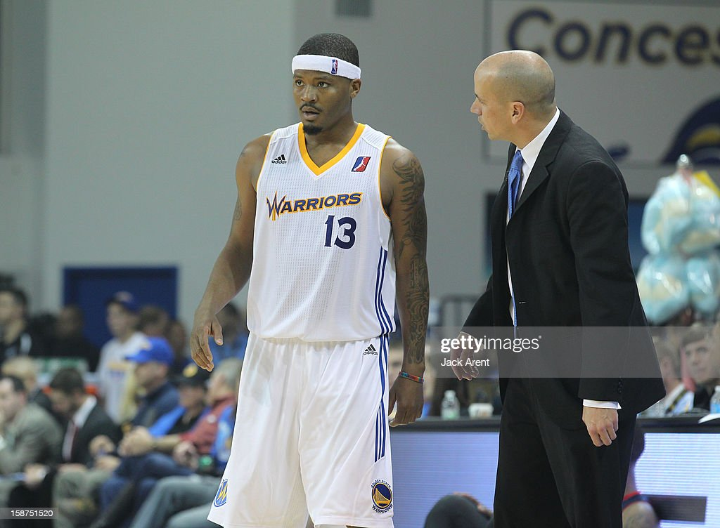 Stefhon Hannah #13 and Nate Bjorkgren, head coach of the Santa Cruz Warriors talk to each other during free throws while playing against the Bakersfield Jam on December 23, 2012 at Kaiser Permanente Arena in Santa Cruz, California.
