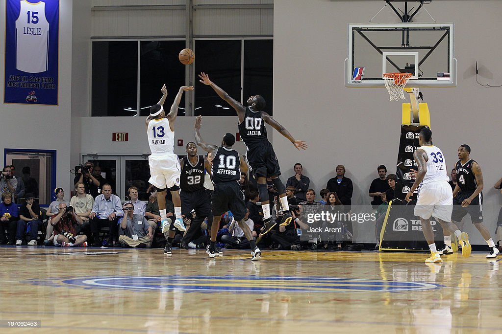 Stefhon Hannah #13 of the Santa Cruz Warriors shoots the ball against Rick Jackson #00 and Dontell Jefferson #10 of the Austin Toros in an NBA Development League Playoff Game on April 19, 2013 at Kaiser Permanente Arena in Santa Cruz, California.