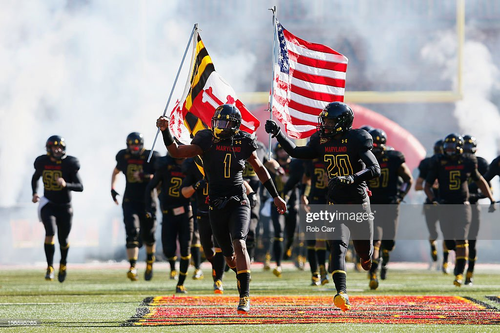 Stefon Diggs #1 and Anthony Nixon #20 of the Maryland Terrapins carry the flags as the team is introduced before the start of their game against the Florida State Seminoles at Byrd Stadium on November 17, 2012 in College Park, Maryland.