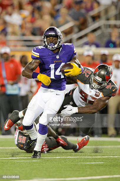 Stefon Diggs of the Minnesota Vikings avoids a tackle by Kwon Alexander and William Gholston of the Tampa Bay Buccaneers during the preseason game on...