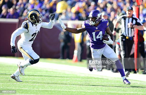 Stefon Diggs of the Minnesota Vikings carries the ball for a gain while Janoris Jenkins of the St Louis Rams applies pressure in the fourth quarter...