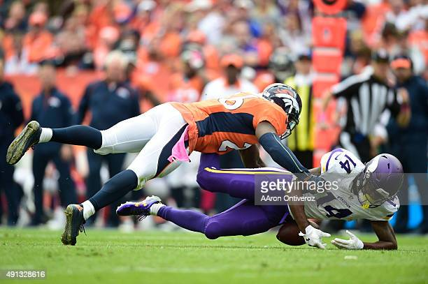 Stefon Diggs of the Minnesota Vikings fumbles the ball as Darian Stewart of the Denver Broncos makes the hit in the second quarter The Denver Broncos...