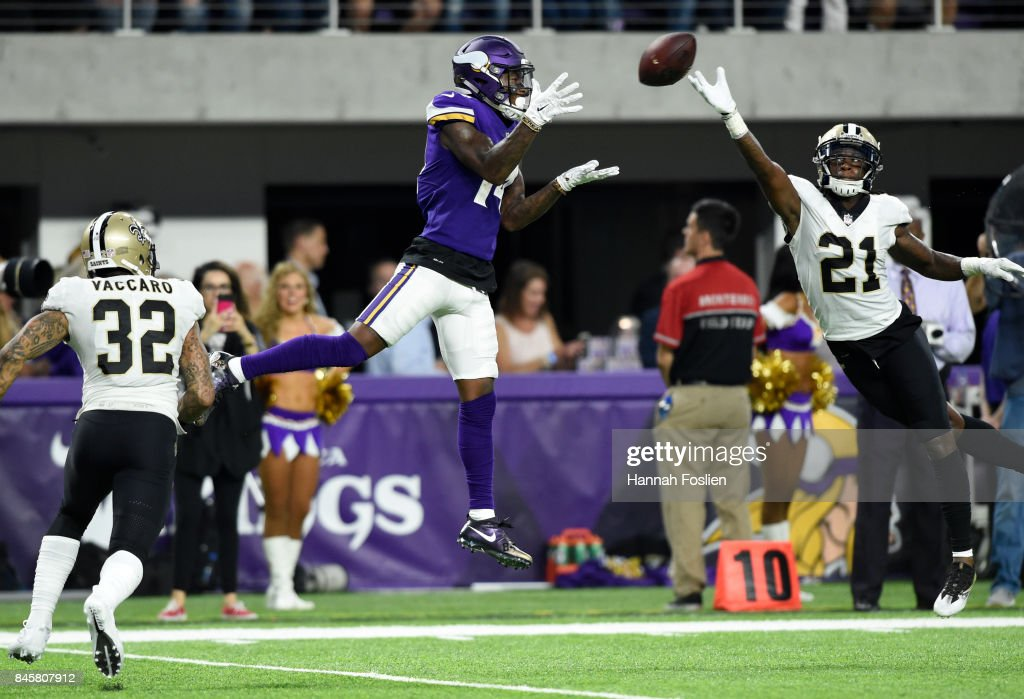 Stefon Diggs #14 of the Minnesota Vikings makes a contested catch late in the first half of the game against the New Orleans Saints on September 11, 2017 at U.S. Bank Stadium in Minneapolis, Minnesota.