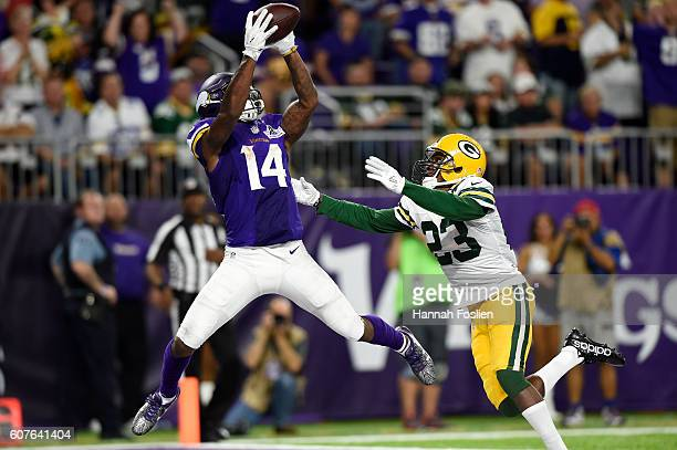 Stefon Diggs of the Minnesota Vikings makes a leaping catch for a touchdown over defender Damarious Randall of the Green Bay Packers in the third...