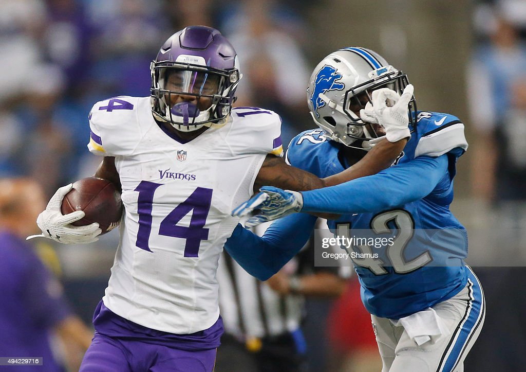 Stefon Diggs #14 of the Minnesota Vikings runs the ball in the second quarter while being defended by Isa Abdul-Quddus #42 of the Detroit Lions at Ford Field on October 25, 2015 in Detroit, Michigan.