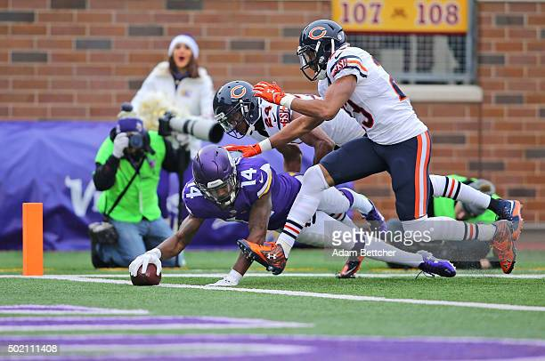 Stefon Diggs of the Minnesota Vikings scores a touchdown against Kyle Fuller and Alan Ball of the Chicago Bears in the third quarter on December 20...