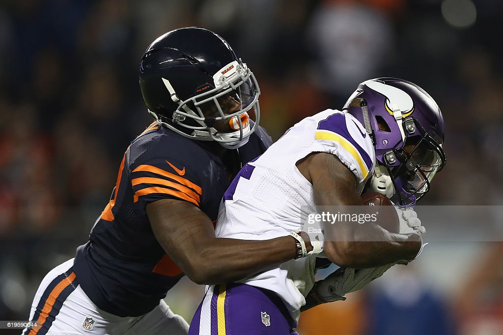 Stefon Diggs #14 of the Minnesota Vikings scores a touchdown as he is defended by De'Vante Bausby #20 of the Chicago Bears during the fourth quarter of their game at Soldier Field on October 31, 2016 in Chicago, Illinois.