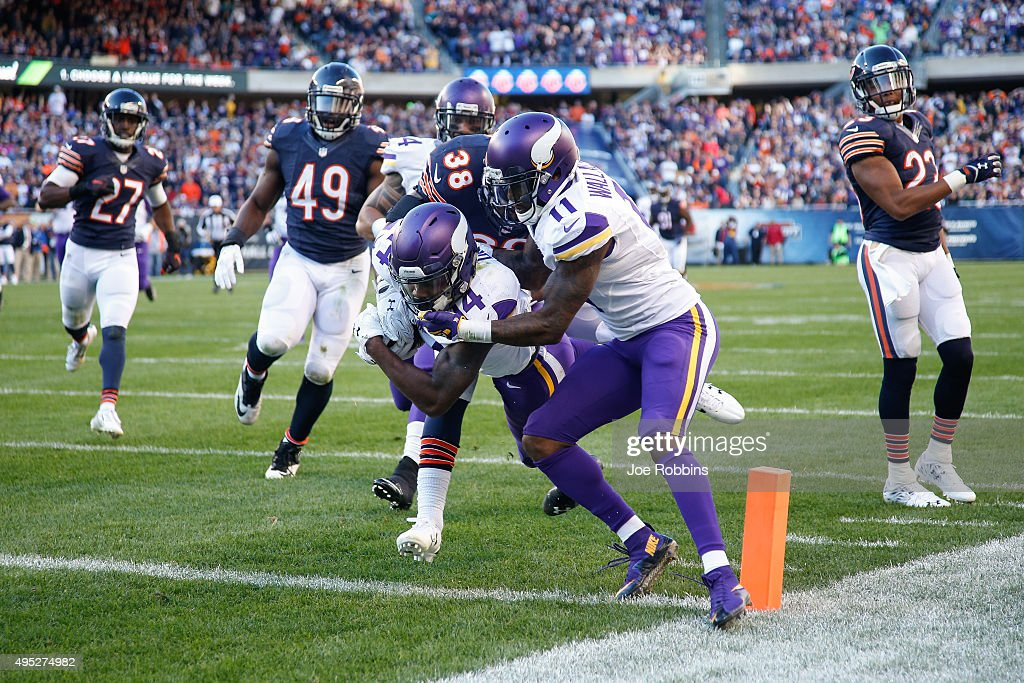 Stefon Diggs #14 of the Minnesota Vikings scores a touchdown in the fourth quarter against the Chicago Bears at Soldier Field on November 1, 2015 in Chicago, Illinois. The Minnesota Vikings defeat the Chicago Bears 23-20.