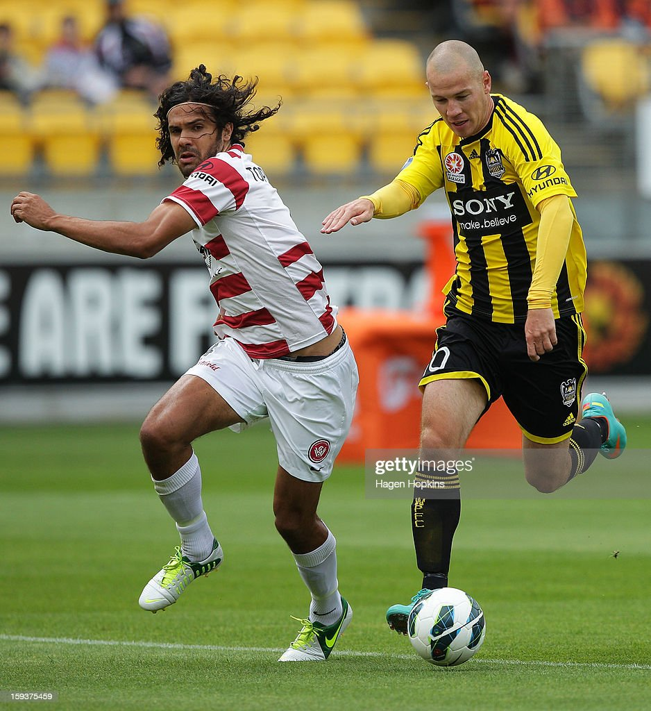 Stein Huysegems of the Phoenix makes a break away from Nikolai Topor-Stanley of the Wanderers during the round 16 A-League match between the Wellington Phoenix and the Western Sydney Wanderers at Westpac Stadium on January 13, 2013 in Wellington, New Zealand.