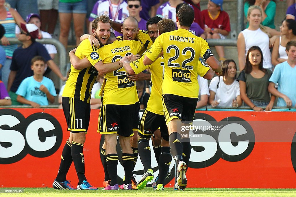 Stein Huysegems of the Wellington Phoenix is congratulated by team-mates after scoring the Phoenix's second goal during the round 25 A-League match between the Perth Glory and the Wellington Phoenix at nib Stadium on March 17, 2013 in Perth, Australia.