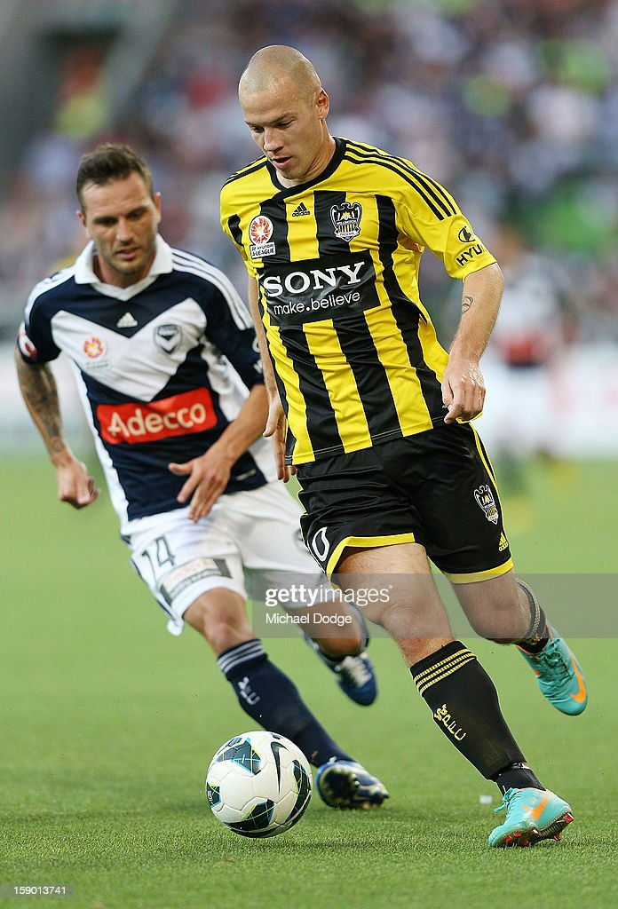 Stein Huysegems of the Wellington Phoenix runs with the ball during the round 15 A-League match between the Melbourne Victory and Wellington Phoenix at AAMI Park on January 5, 2013 in Melbourne, Australia.