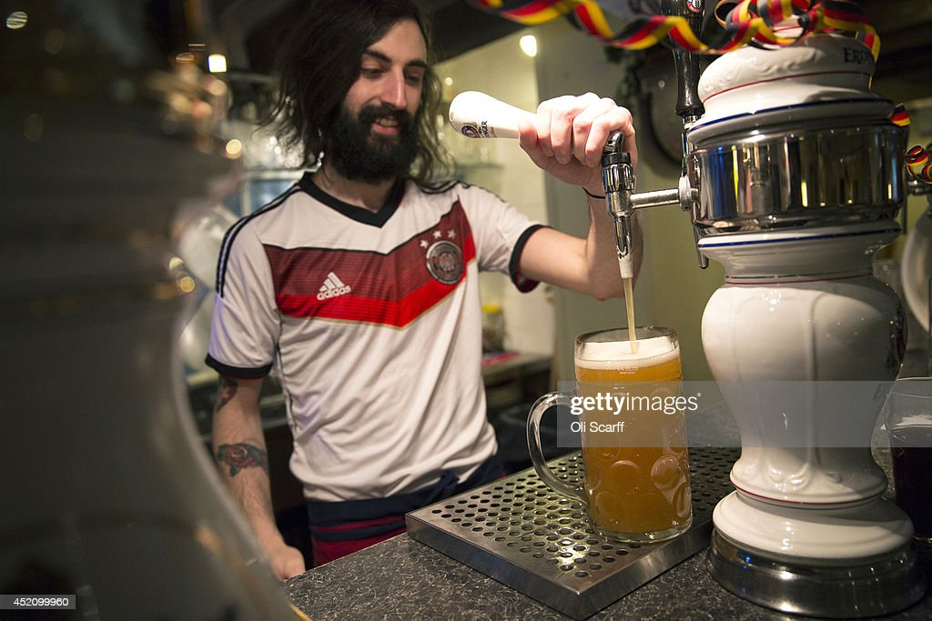 Steins of German beer are poured prior to the FIFA World Cup final in the 'Bavarian Beerhouse' pub in East London on July 13, 2014 in London, England. The FIFA World Cup final will take place in the Maracana Stadium in Rio de Janeiro between Germany and Argentina, with an expected global television audience of more than a billion viewers.