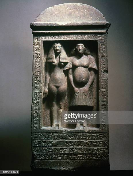 A stela with figures of the sculptor Bak with his wife Tahere This unusual self portrait of the sculptor shows some of the physical characteristics...