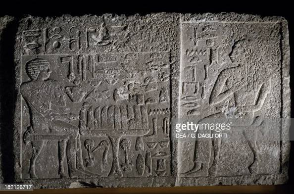 Stele with relief depicting the deceased Iter assigned to the king and his wife Pereretnefer knowing the king and the priestess of Neith in front of...