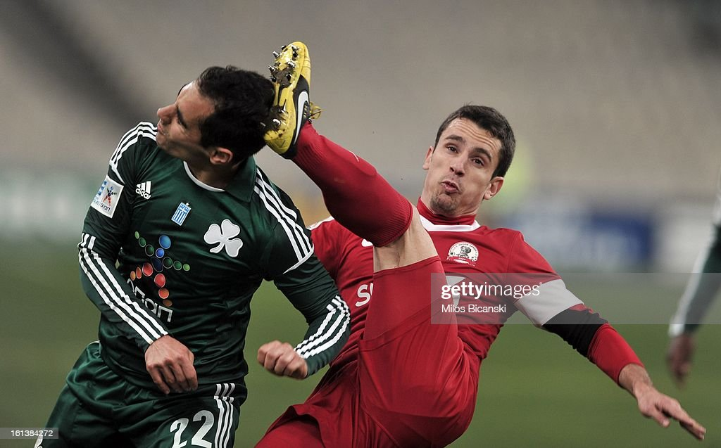 Stelios Marinos (L) of Panathinaikos FC competes for the ball with Duca Emil of Skoda Xanthi during the Superleague match between Panathinaikos FC and Skoda Xanthi at OAKA Stadion on February 10, 2013 in Athens,Greece.