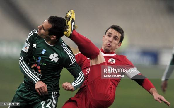 Stelios Marinos of Panathinaikos FC competes for the ball with Duca Emil of Skoda Xanthi during the Superleague match between Panathinaikos FC and...