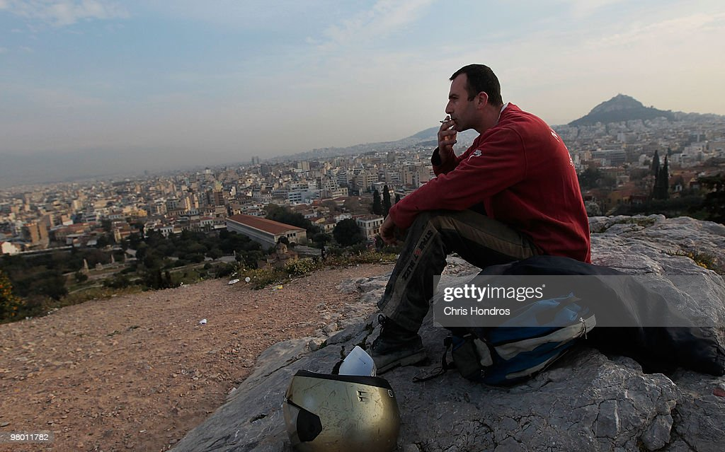 Stelious Kladakis, an out-of-work freelance building contractor, sits smoking a cigarette in the early-morning hours near the Acropolis rock on March 24, 2010 in Athens, Greece. Kladakis had steady work for years until the recent Greek economic crisis brought many construction projects to a halt. Higher prosperity made its way to once-unfashionable Greece in the last 15 years since the small country began reforming its economy to join the euro zone. But some argue that Greece overextended itself, and fellow European nations negotiated March 24 over what role the International Monetary Fund could play in European Union efforts to alleviate Greece's debt crisis. Greece's debt and economic woes have prompted forced austerity measures as a condition of staying in the European Union, and EU-heavyweight Germany has opposed a bailout of the fragile, debt-ridden Greek economy.