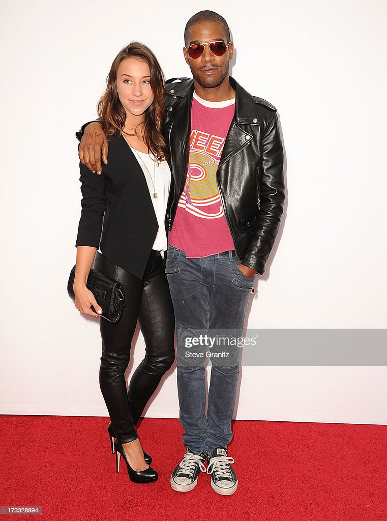 Stella Maeve and Kid Cudi arrives at the 'RED 2' - Los Angeles Premiere at Westwood Village on July 11, 2013 in Los Angeles, California.