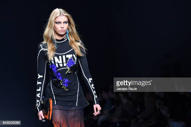 Stella Maxwell walks the runway at the Versace show during Milan Fashion Week Fall/Winter 2017/18 on February 24 2017 in Milan Italy