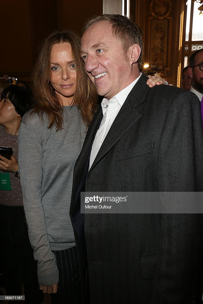 Stella McCartney (L) and Francois Henri Pinault attend the Stella McCartney Fall/Winter 2013 Ready-to-Wear show as part of Paris Fashion Week on March 4, 2013 in Paris, France.