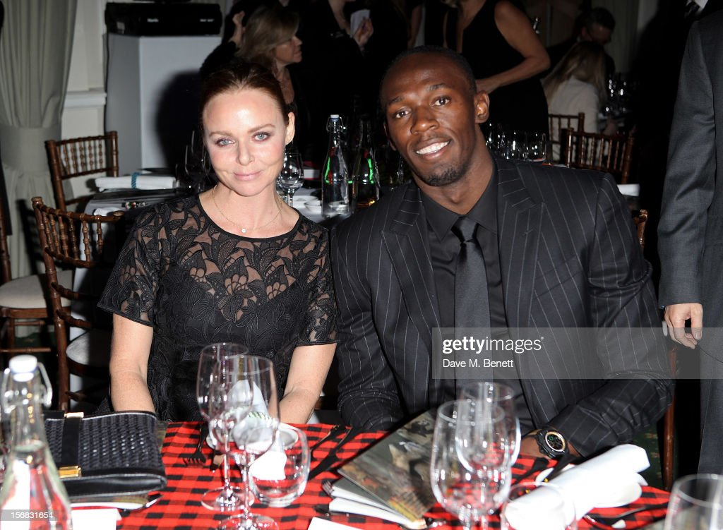 Stella McCartney (L) and Usain Bolt attend the Zeitz Foundation and ZSL Gala at London Zoo on November 22, 2012 in London, England.