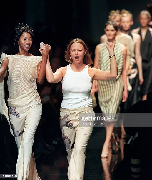 Stella McCartney daughter of Beatles star Paul McCartney cheers the audience after the show for her label Chloe 11 October 2000 in Paris during the...