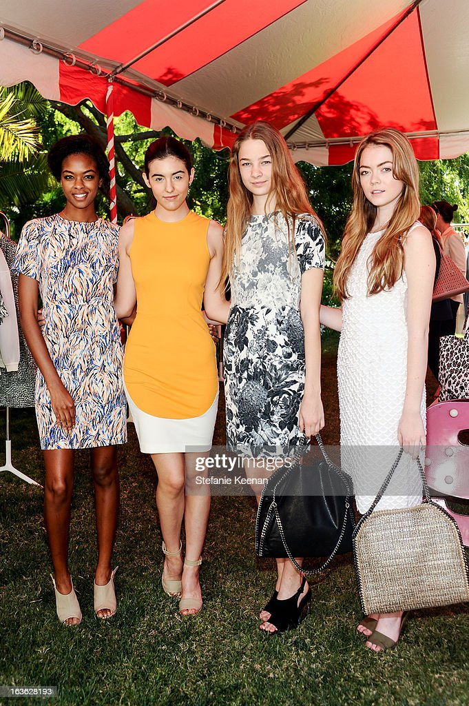 Stella McCartney poses with models at the HEART/Stella McCartney Brunch on March 13, 2013 in Beverly Hills, California.