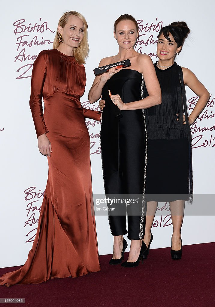 Stella McCartney (C), winner of Designer of the Year poses in the awards room with <a gi-track='captionPersonalityLinkClicked' href=/galleries/search?phrase=Amber+Valletta&family=editorial&specificpeople=206940 ng-click='$event.stopPropagation()'>Amber Valletta</a> and <a gi-track='captionPersonalityLinkClicked' href=/galleries/search?phrase=Salma+Hayek&family=editorial&specificpeople=201844 ng-click='$event.stopPropagation()'>Salma Hayek</a> (R) at the British Fashion Awards 2012 at The Savoy Hotel on November 27, 2012 in London, England.