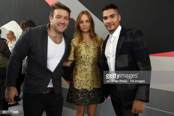 Stella McCartney with Olympians Dan Greaves and Louis Smith as they attend the Adidas by Stella McCartney presentation part of London Fashion Week