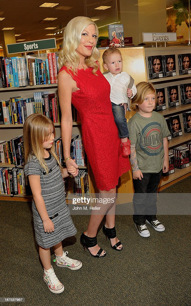 Stella McDermott, Tori Spelling, Finn McDermott and Liam McDermott attend the signing for her new book 'Spelling It Like It Is' at the Barnes & Noble bookstore at The Grove on November 9, 2013 in Los Angeles, California.