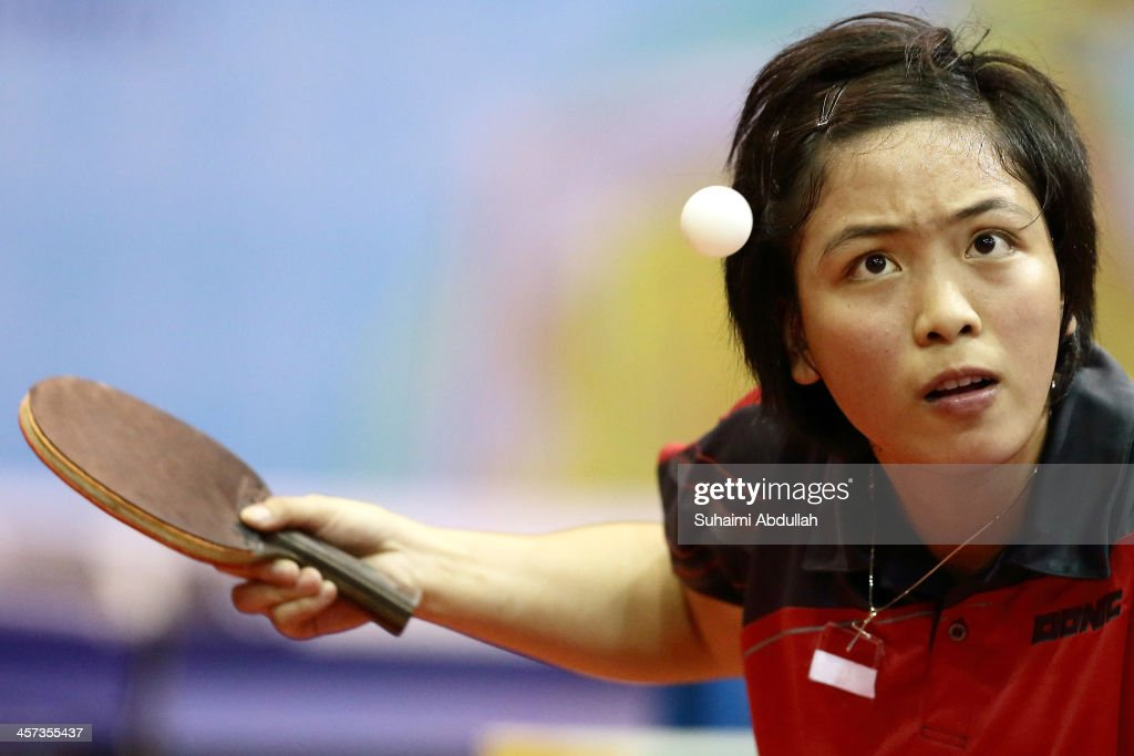 Stella Priska Palit of Indonesia serves during the table tennis women's team event between Indonesia and Singapore at Wunna Theikdi Indoor Stadium C during the 2013 SEA Games on December 17, 2013 in Nay Pyi Taw, Burma.